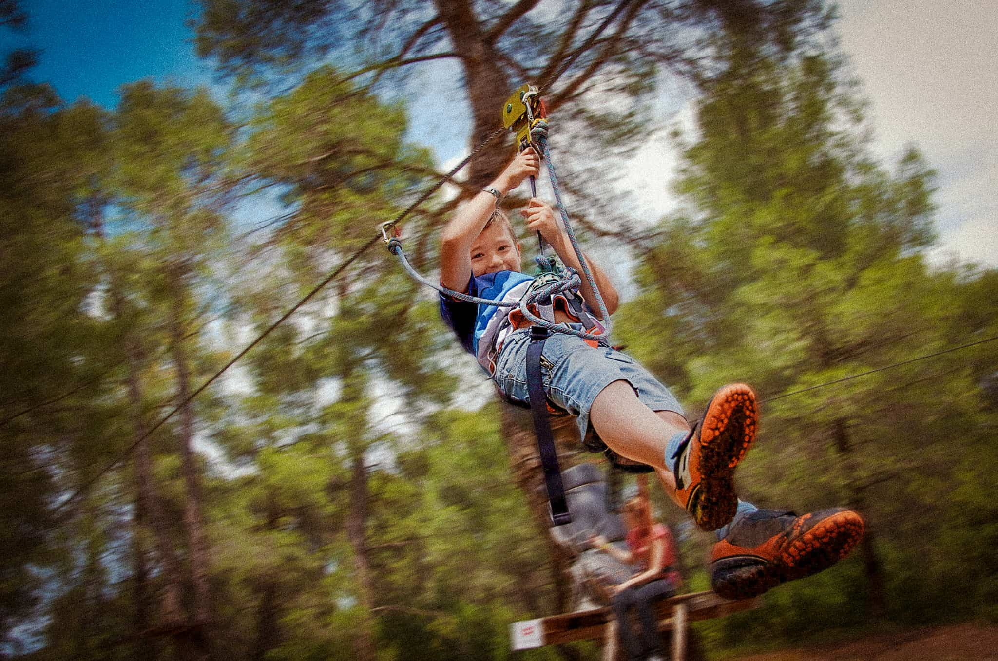 Leisure,and,activities,on,nature.,small,boy,hanging,and,rolling